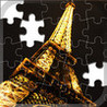 Jigsaws Paris - The jigsaw game including Eiffel Tower at night with lazors and the Arc de Triomphe Image